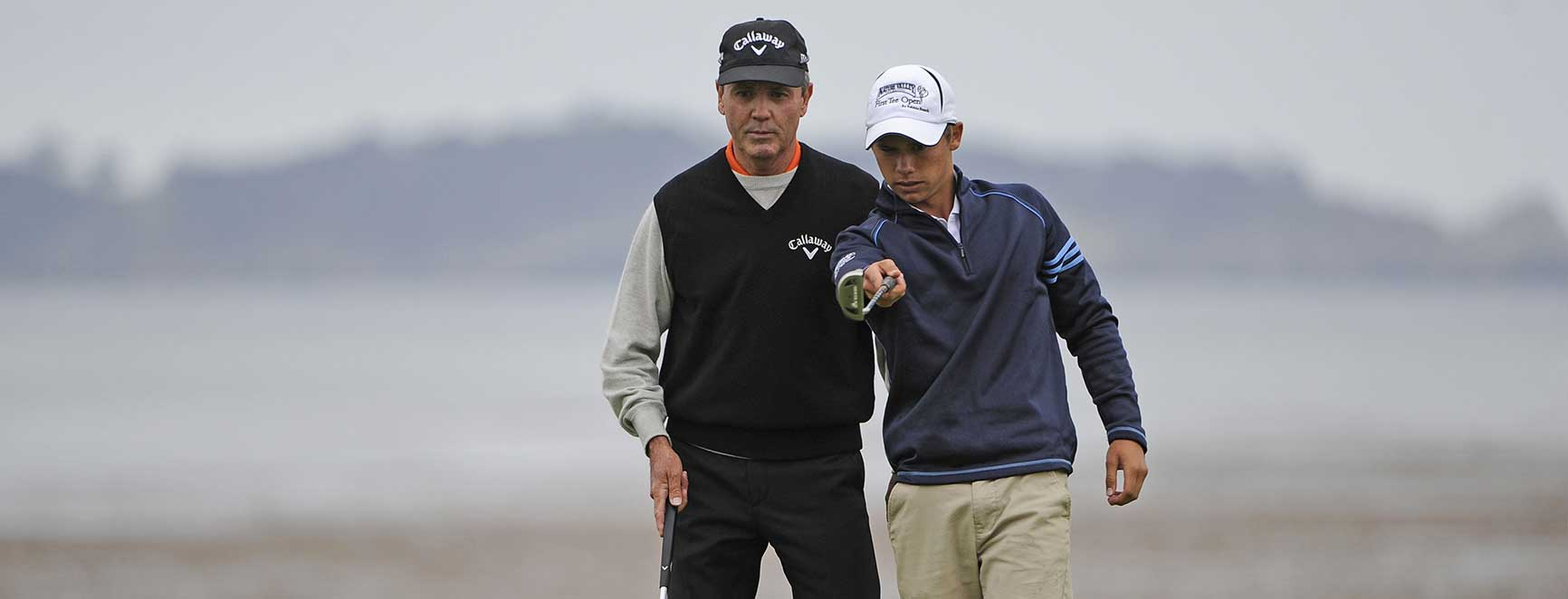 Mark advising a younster on a putt