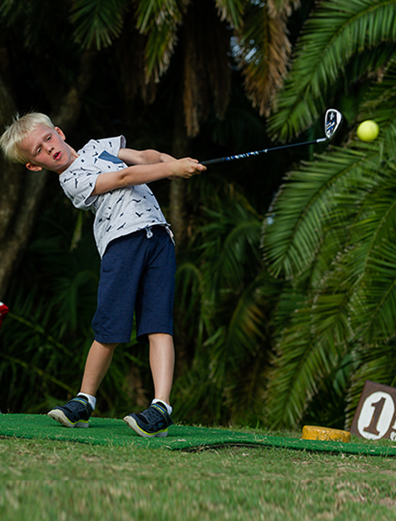 Young boy playing a good shot