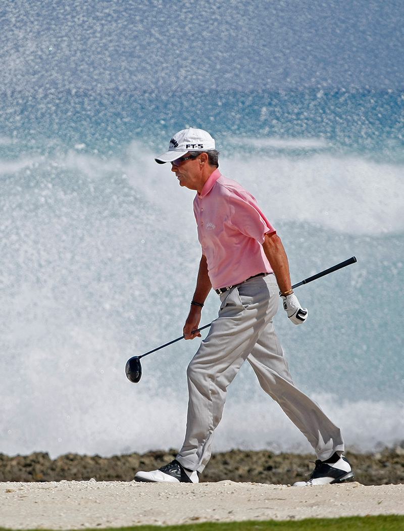 Mark McNulty Professional Golfer in front of waves